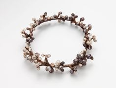 "Tehri Tolvanen: ""Perles"", 2012 Faceted pearls, heather wood, silver"