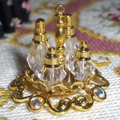 TABLE SETTINGS::  later era cruet set (from jewelry findings) - The first cruets were introduced at the end of the 17th Century