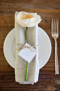 Paper flower and burlap napkin tied together with a rope string