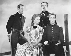 Publicity still from Fort Apache (1948). John Wayne as Captain Kirby York, Shirley Temple as Philadelphia Thursday, Henry Fonda as Lieutenant Colonel Owen Thursday, and John Agar as 2nd. Lieutenant Michael Shannon O'Rourke.