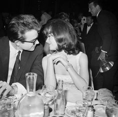 Warren Beatty and Natalie Wood. Young Hollywood in Love in the 1960s. a classic, candid, black and white photo of Hollywood stars having dinner, in love