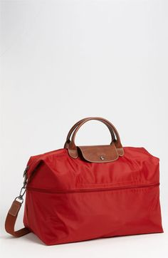 I have been thinking about getting a weekender bag and this Longchamp 'Le Pliage' Expandable Travel Bag in deep red is PERFECT
