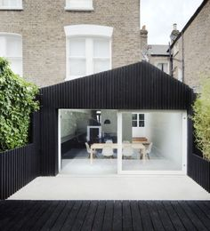 Blackened larch extension onto the rear of a Victorian terrace in south London