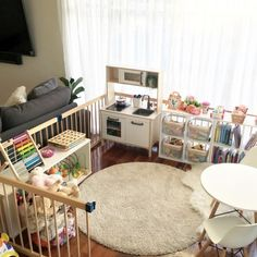 Organised Kids Play Area Idea-this is a simple playpen in our lounge room that I have progressively turned into a mini play room as my daughter got older. Starting small with a rug and a few toys when