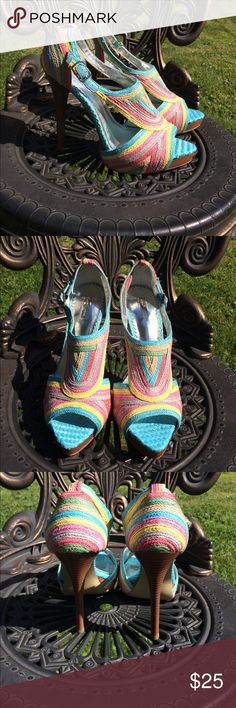 "Report Signature Colorful Heels Sz 8 Report Signature Colorful Woven Heels size 8. Has slight marks on. It tons of shoes - in excellent condition. 5"" Heels Report Signature Shoes Heels"