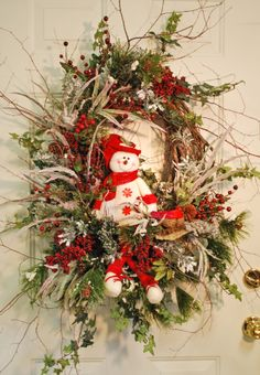 "The ""wild"" style of the birch and beech stems radiating out all around from the tighter center circle of the wreath."