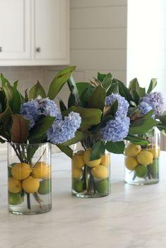 Citrus + Hydrangea + Magnolia Summer Flower Arrangement. Such a cute idea for a summer dinner party!