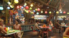 A detail of the dining area and stage in Big Momma's interior with the house…