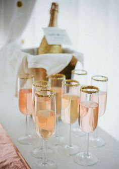 10 Ways to Spice Up Your Signature Drink: serve champagne over cotton candy, popsicles or rim it with edible glitter