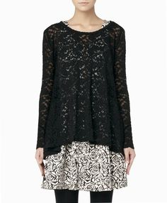 Black lace top. I love this because you can wear is with skinny jeans and flats or dress it up with a flirty patterned skirt. I love versitile pieces like this.