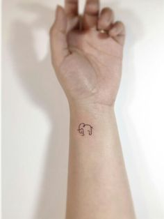 Elephant tattoo - best tiny tattoos Watch others in the gallery