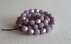 50 Opaque Lavender Luster Faceted 4mm Rounds - Czech Glass Beads. $1.95, via Etsy.