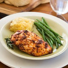 A rub seasoned with paprika, rosemary, and garlic gives this low calorie chicken recipe lively flavor while a balsamic-vinegar drizzle adds subtle sweetness.