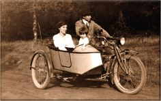 Motorcycle with side car. My mother and her parents