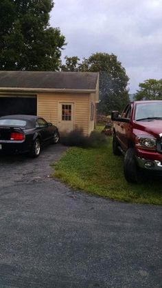 black Ford Mustang with diesel truck smoke