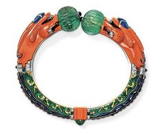 CARTIER: 1928 Chinese-inspired bracelet, originally belonging to opera singer Ganna Walska, is full of enamel, coral, diamonds, and sapphires. One of the dragon heads twists to open the bracelet.