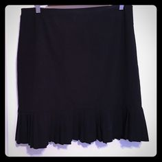 Black skirt Black skirt with ruffle detail at hem. 21 inches long and waist is 16 inches laying flat. Polyester and rayon blend material. Skirts Mini