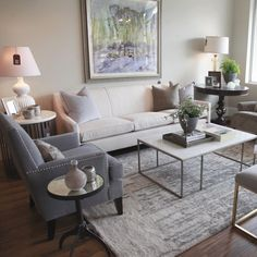 Wonderland by Alice Lane   White and gray living room vignette with marble top coffee table.
