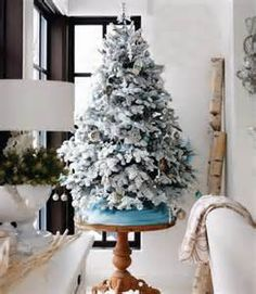 Frosted Christmas Tree on pedestal table.I like the effect of the tree on the table White Christmas Tree Decorations, Frosted Christmas Tree, Creative Christmas Trees, Flocked Christmas Trees, Tabletop Christmas Tree, Small Christmas Trees, White Ornaments, Xmas Trees, Christmas Fabric