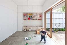 big sliding door to outside play  by Architect Hannah Tribe