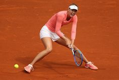 Mutua Madrid Open - Day Two - Maria Sharapova of Russia in action against Timea Bacsinszky of Switzerland in their second round match during day one of the Mutua Madrid Open tennis tournament at the Caja Magica on May 3, 2015 in Madrid, Spain.