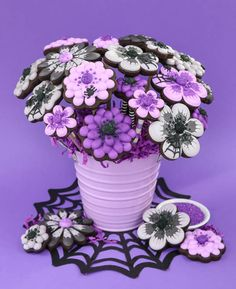 Spooky Halloween Cookie Bouquet by Toni Miller of Make Bake Celebrate! Use Wilton's Color Right Color Performance to achieve the black and purple color palette shown in the photo.
