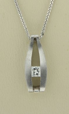 Our Diamond Solitaire Pendant, 14 karat white gold, set with one 0.24 carat princess cut Diamond with an I1 clarity and a D color. Chain not included.