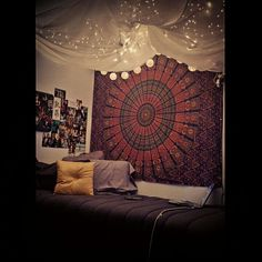My Dorm for my Sophomore year. Tapestry ordered online, bedset from Bed Bath and Beyond. Ceiling done with just a few thumbtacks, lights, & a sheer curtain! #tapestry #crafty #lights #dormideas