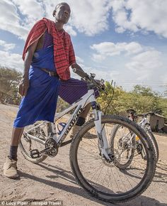 New ride: The village elder, known as Isaac, took to a mountain bike to mark the…