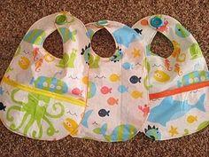 Vinyl table cloth cut up and sewn into baby bibs.  Genius idea!!!