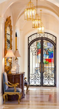 Hallway with Groin Vault Arched Ceiling and Wrought Iron Double Doors