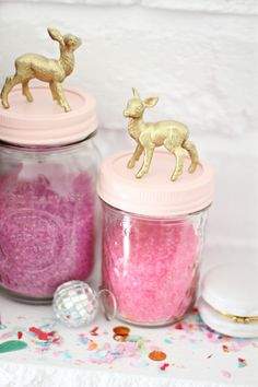 In love with these mason jars...the lids have been spray painted...spray paint small animal figurines and glue to top of lid.