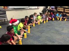 "6th Graders review the cup game. We used it as a way to learn ""tim-ka"" or dotted eighth followed by a 16th. (as in ""pick-it"" up). We will be adding variation..."