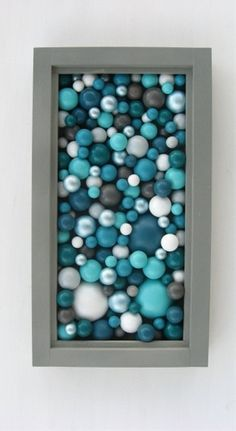 Get cheap beads at the dollar store and put in a shadow box.  What a great idea!!!