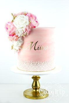 One tier pink watercolour cake with edible lace, golden hand painted name and flowers. How to paint onto fondant tutorial at www.vimeo.com/ondemand/cakingitup