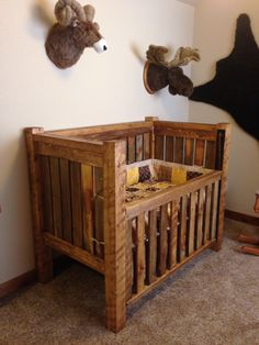 Rustic baby crib and hunting lodge bedroom.