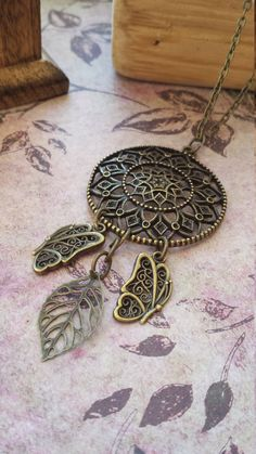 Check out this item in my Etsy shop https://www.etsy.com/uk/listing/264670557/dreamcatcher-pendant-statement-necklace