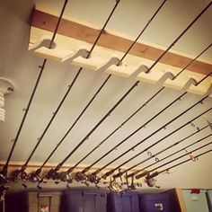 Hang your fishing rods from a ceiling rack to keep them out of the way. | 38 Borderline Genius Ways To Organize Your Garage