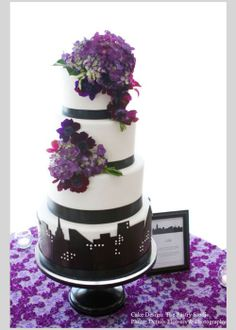 As a city girl myself, I cannot help but love this cityscape cake design by The Pastry Studio. And, purple, one of the hottest color trends right now, makes a fabulous appearance in the flowers on the cake and table linen. Photo by Details Flowers & Photography. #cakestand, #wedding, #cake, #black, #sarahsstands, #pastrystudio