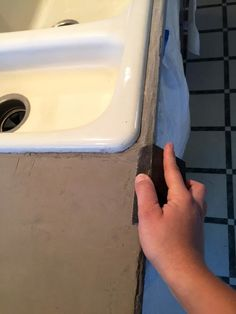 hand sanding the front edge of my DIY feather finish concrete over tile counters Painting Tile Countertops, Diy Concrete Countertops, Tile Counters, Kitchen Countertops, Laminate Counter, Stained Concrete, Concrete Lamp, Concrete Floors, Concrete Shower