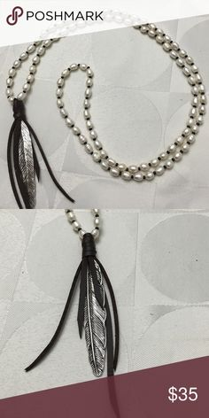 Long fresh water pearl necklace Long boho style necklace. All white pearls adorned with a silver hanging leaf and a brown leather tassel. You could throw this over a tee shirt, a blouse or wear it with your favorite bikini, very sexy! Jewelry Necklaces