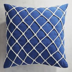 Finely woven and soft to the touch, our Cabana fabric is tough enough for outdoors but pretty enough for indoors. This rope-trimmed pillow will add a nautical touch to your patio or family room.