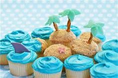 Like the waves on these cupcakes... And the shark fin is cute too!