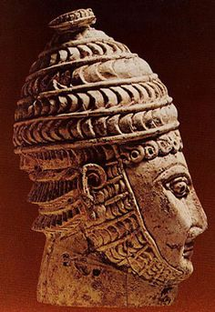 Ivory head of a warrior wearing a boar's tusk helmet, Mycenaean, Late Bronze Age (1600 - 1100 BC) ----- high status helmet of a Mycenaean warrior - as described by Homer.
