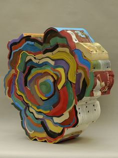 British artist Jonathan Callan makes sculptures of books by twisting and compressing them until no gap remains between and playing on curves, patterns, and colors created by the assembly of their edges.