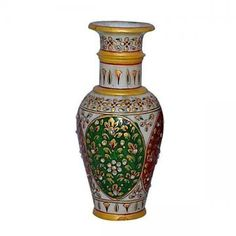 Make your living space and office look fantastic with this glamorous flower vase. Crafted in pure white marble, it is embellished with Meenakari and kundan work that is complemented by expert enamelwork.