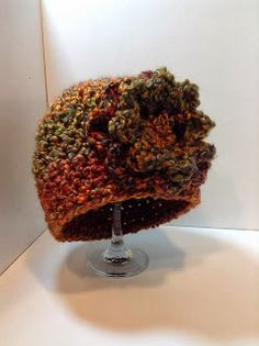 Free crochet pattern to make the hat with a link to the free flower....