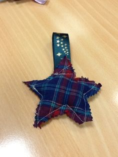 A star Christmas tree decoration made from an old shirt. Hand sewn @ Portland.