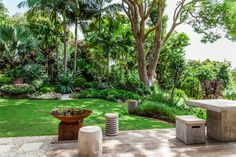 """Working with a large sloping site, landscape designer [Claudia Nevell shaped a many-layered tropical wonderland](http://www.homestolove.com.au/a-tropical-oasis-on-the-nsw-north-coast-2802