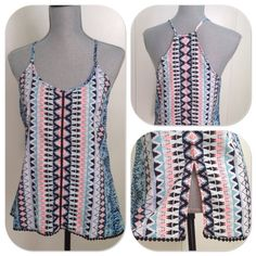"""NWT Japna tribal print top NWT Japna tribal print light and flowing top with spaghetti straps!  Colors are so vibrant!!  Crochet inlay going down the middle of the front, cute scalloped lace on the bottom edge, and a 6"""" slit on the back as shown.  100% polyester. Very cute! Japna Tops Camisoles"""